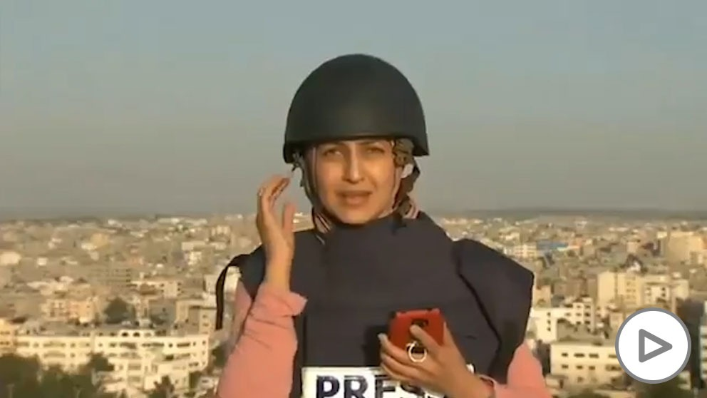 A journalist interrupts her broadcast in the Gaza Strip as an Israel bomb falls a few meters away