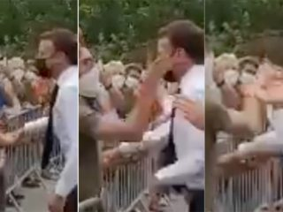A man slaps Macron while greeting citizens on a visit in southeastern France