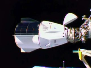 The SpaceX capsule successfully docked with the International Space Station