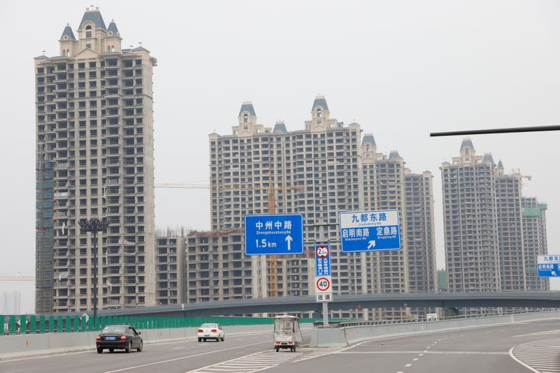 China's Evergrande pays clients with properties for its wealth management products