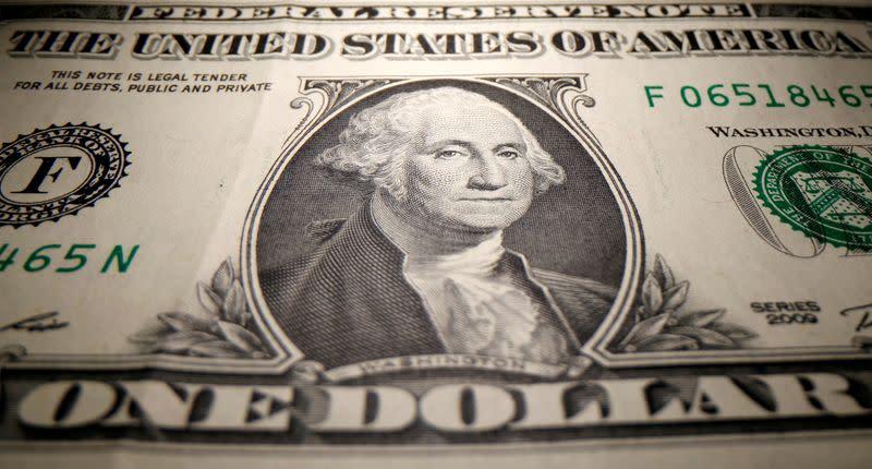 Dollar remains near 3-week high after US data