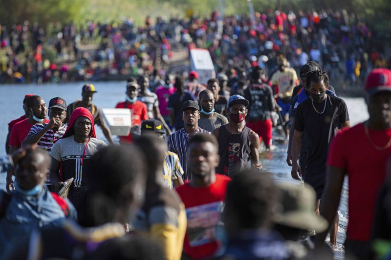 More than 10,000 Haitian migrants held in a precarious camp under a bridge in South Texas