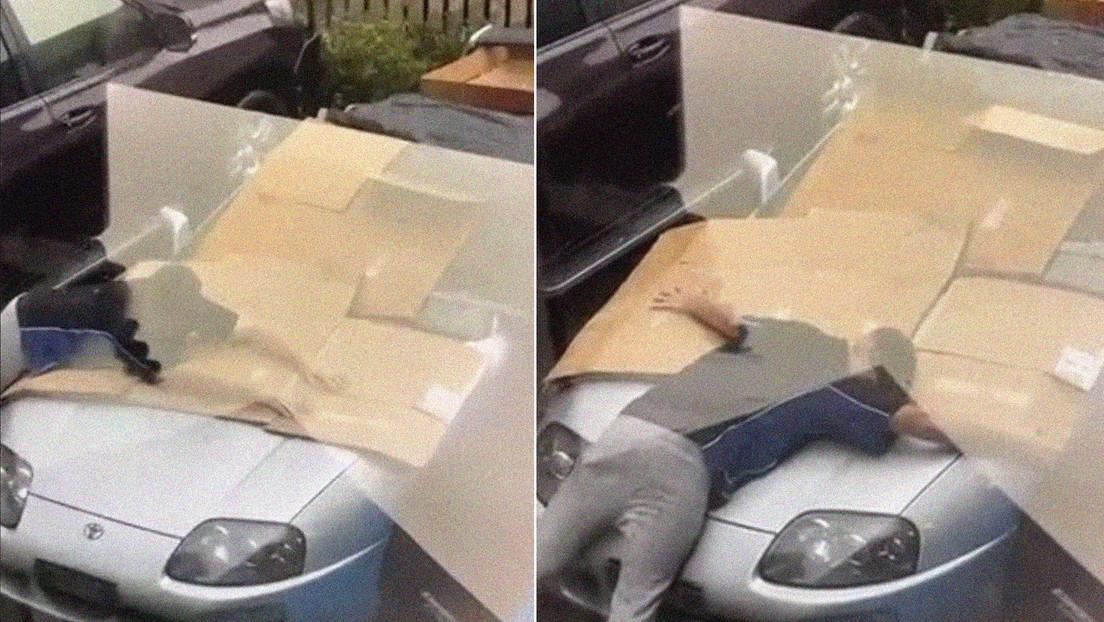 Un joven protege su coche deportivo de una granizada cubriéndolo con su propio cuerpo (VIDEO)