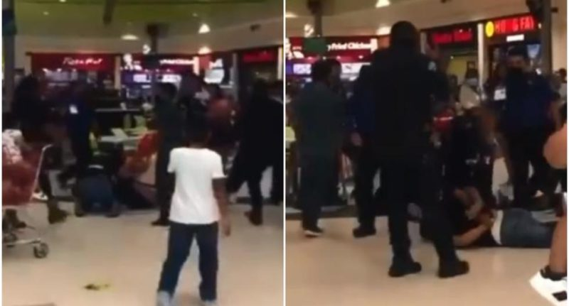Families are beaten by a table in a mall food court - MAG.